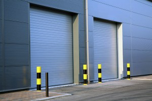 Detail of steel roller-shutter doors on a new industrial unit